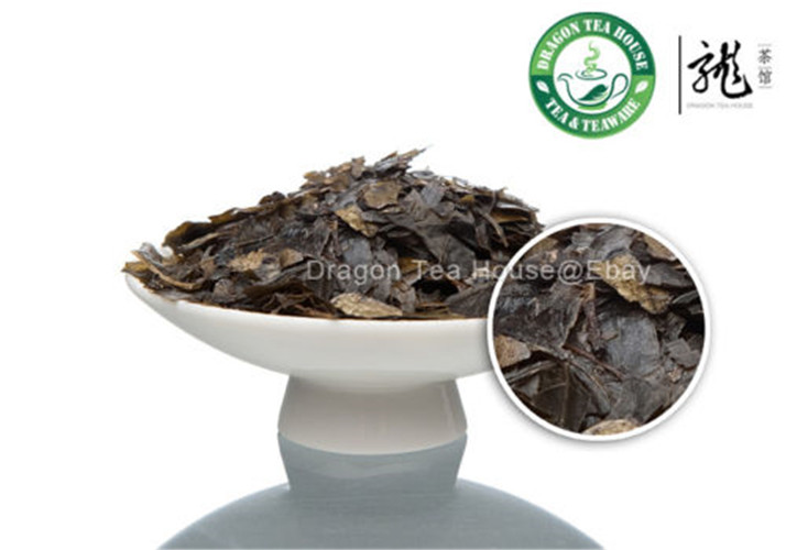 Dragon Tea House 50g premium strip line kuding tea kuding the chinese tea kuding health care loose herbal tea 50g