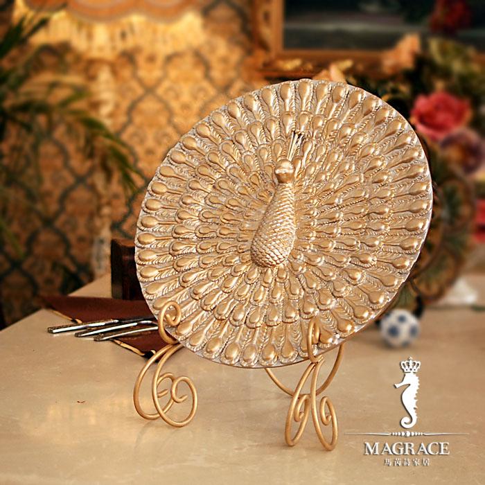 非常特别的一款装饰盘摆件,整体为开屏孔雀的美丽造型       反复图片