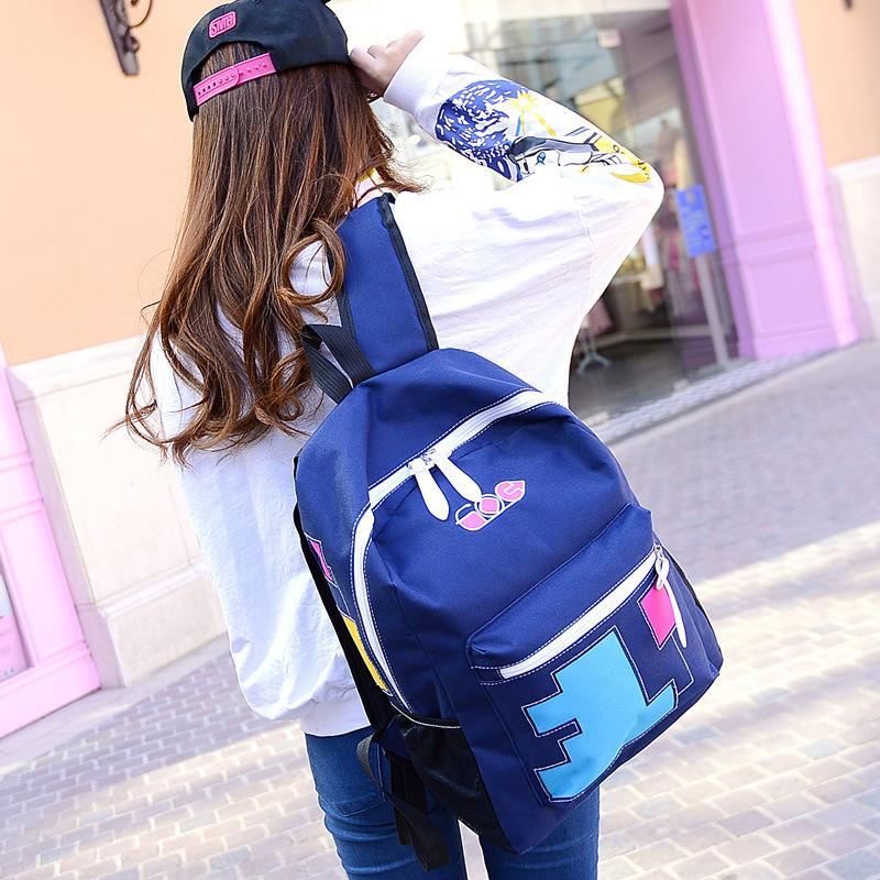 2015韩版帆布印花双肩背撞色女包旅行背包中学生书包图片