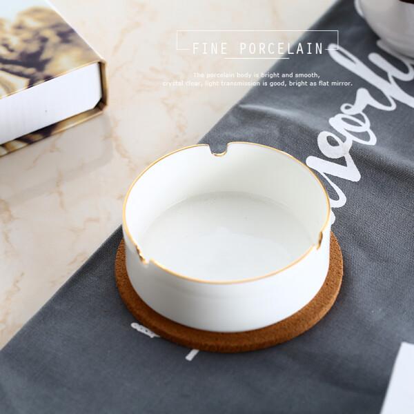 尊慕斯酒店餐厅宾馆家用简约圆形骨瓷金色描边白色烟灰缸