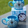 立体叮当猫儿童杯子 卡通叮当色袖水杯可爱陶瓷杯子 机器猫头像杯 kt图片